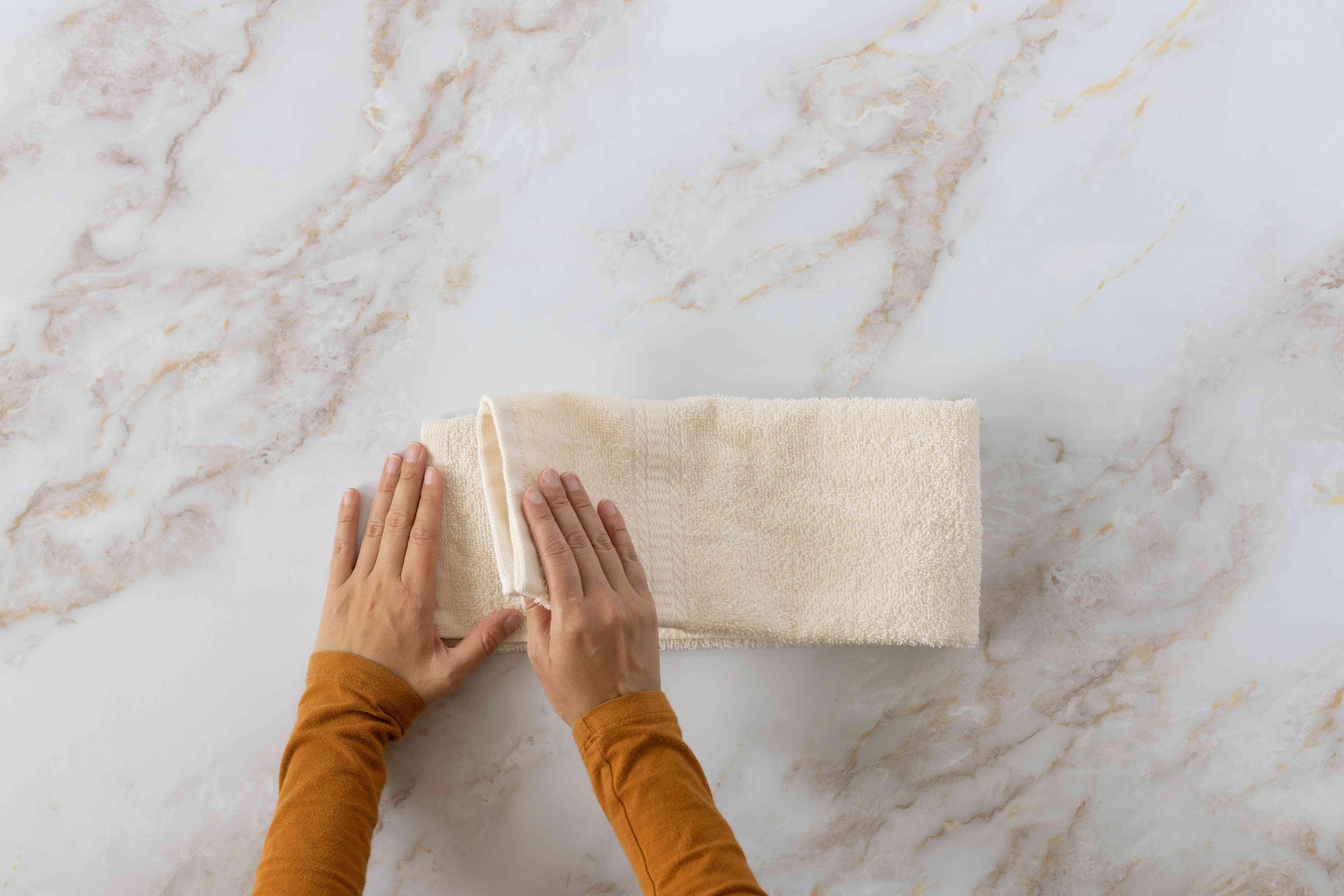 Cream towel as long strip folded in half