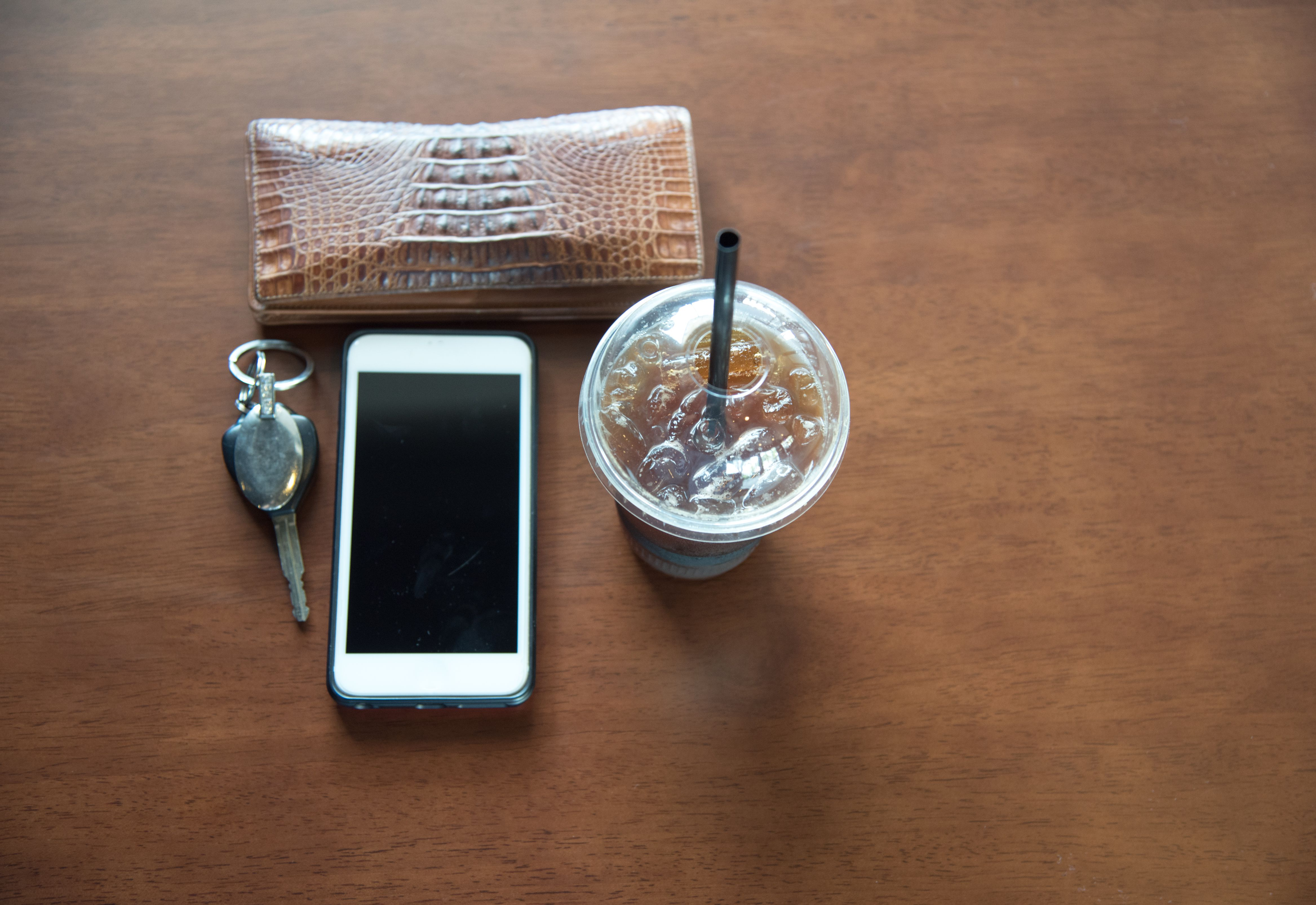 High Angle View of Smart Phone and Drink With Purse