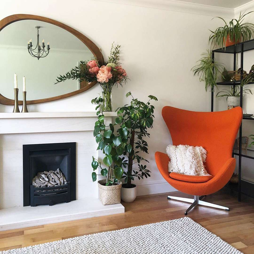 Living room with orange chair