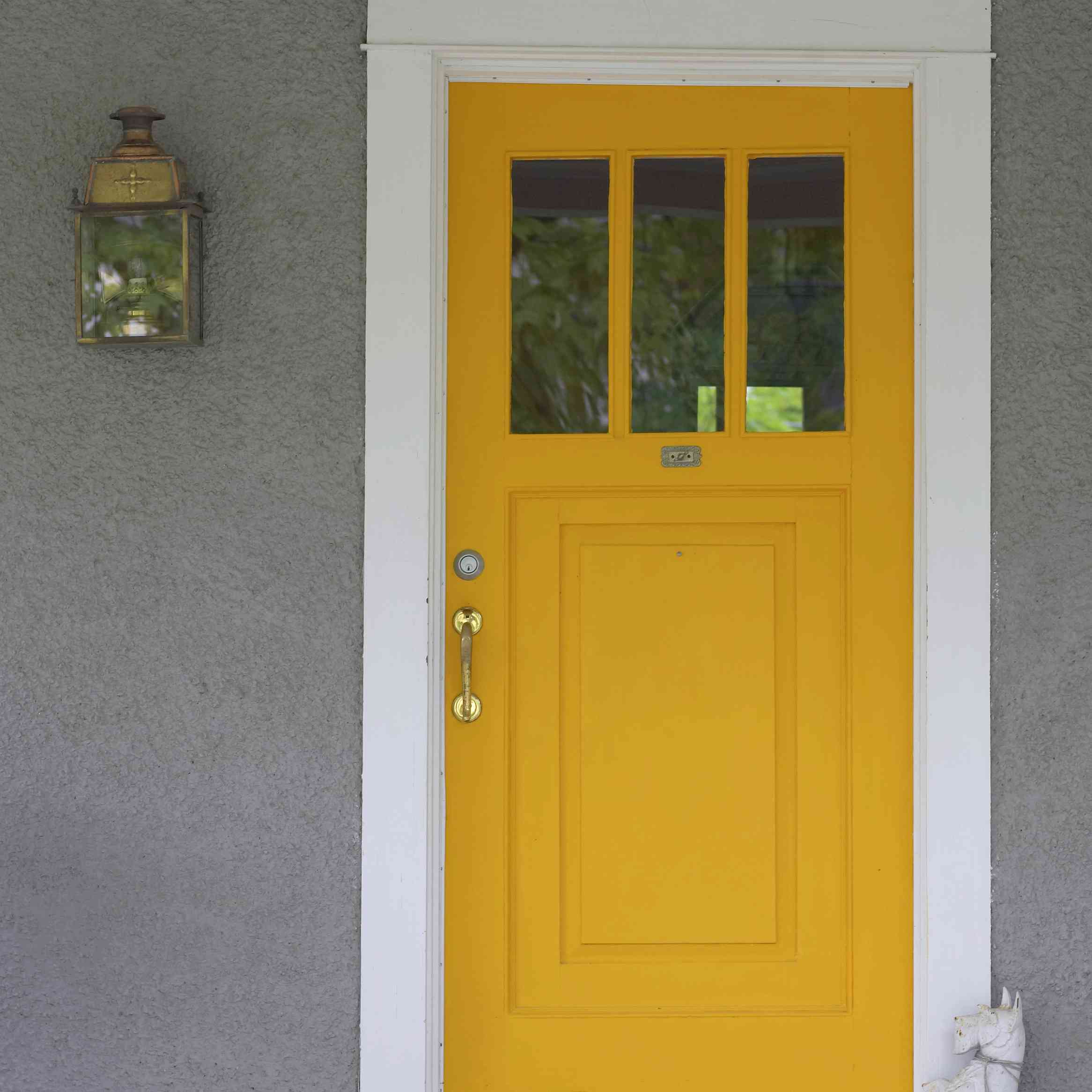 Residential Front Yellow Door. Old colonial house with porch, in North America