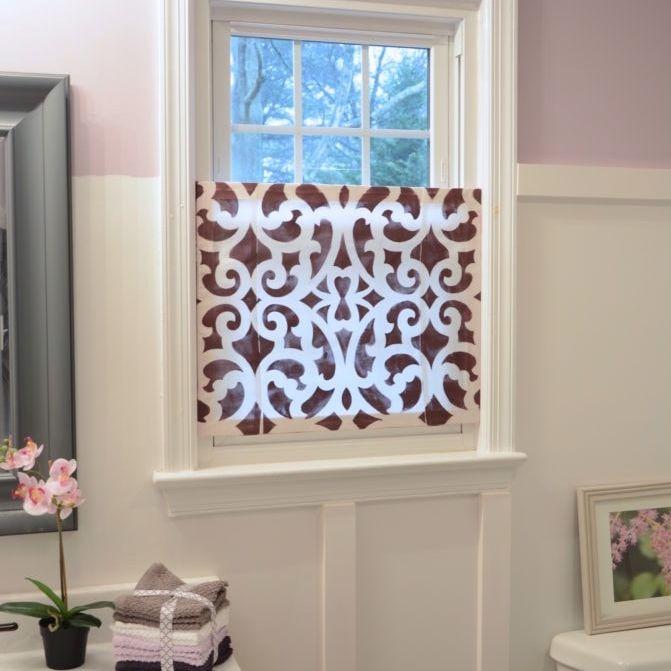 A privacy screen in a bathroom window