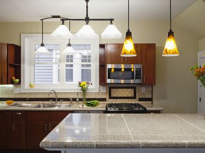 Kitchen with granite tile countertops