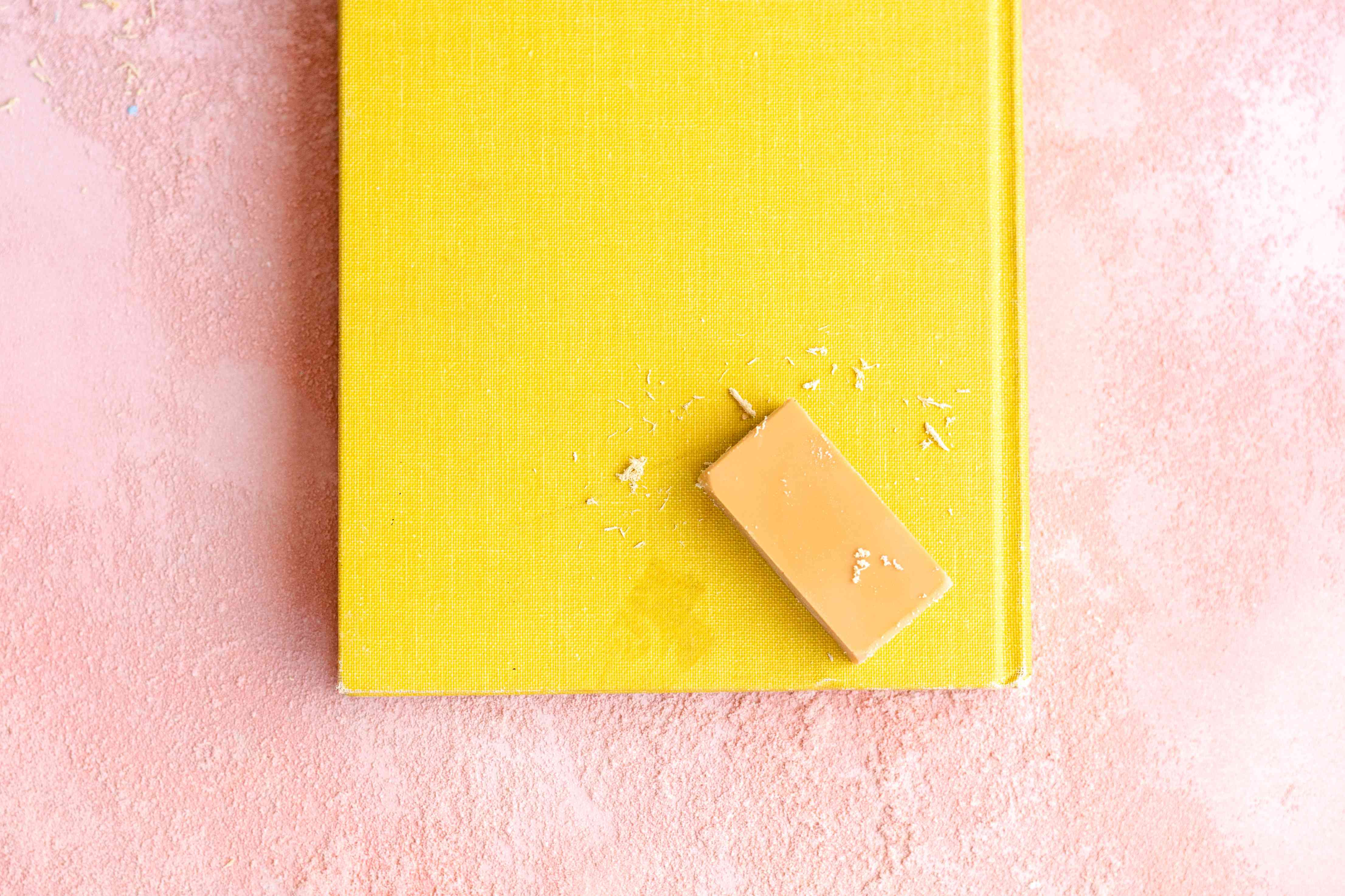 using an eraser to remove smudges from books