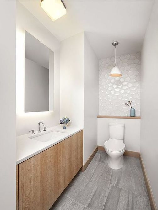 Modern style bathroom with wooden cabinets and slate floor.