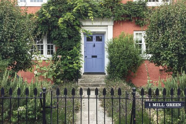 Brick house with a blue door
