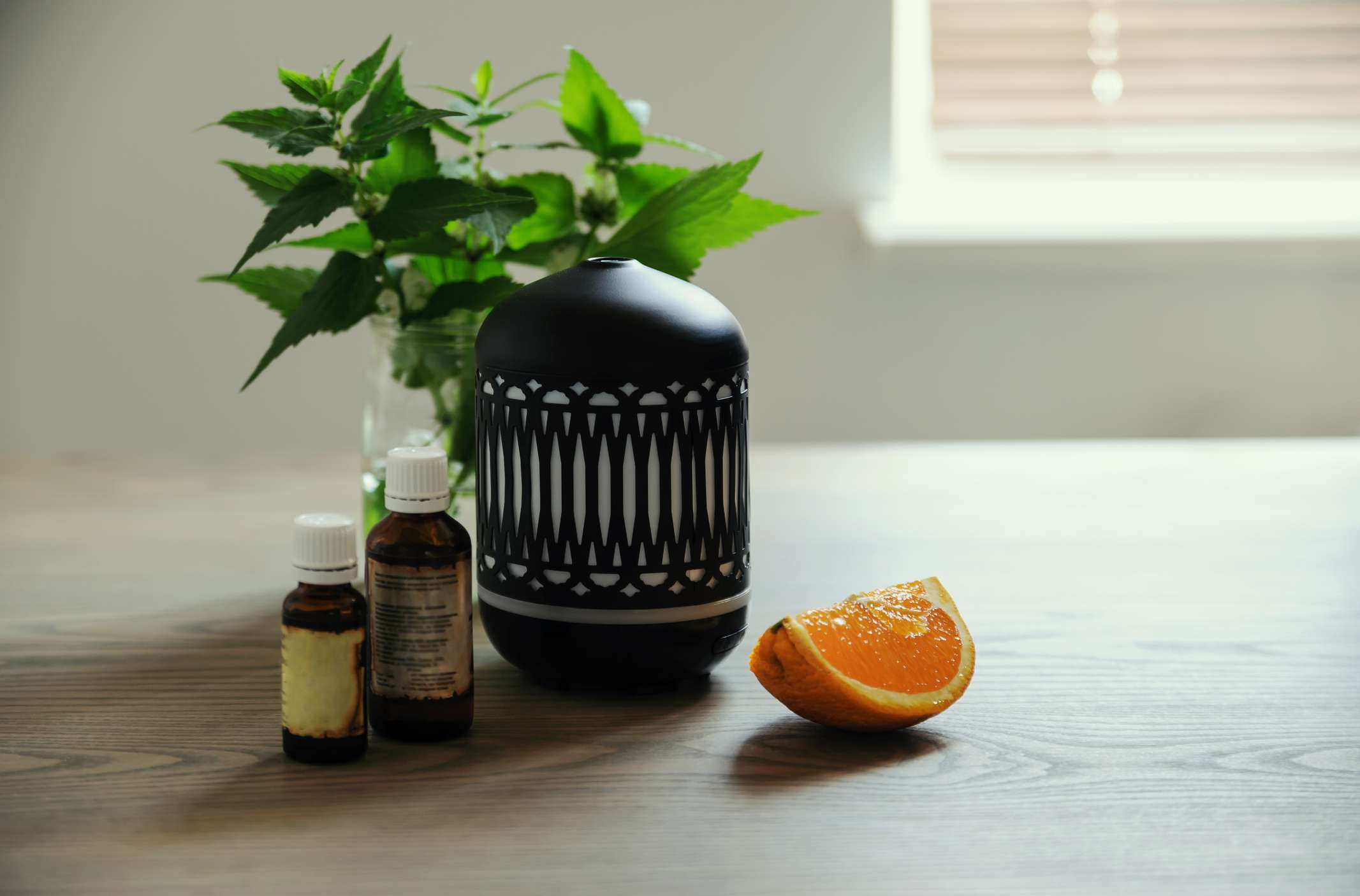 essential oil diffuser with orange slice for space clearing