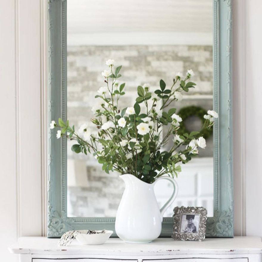 A diy mirror frame using paint and a transfer