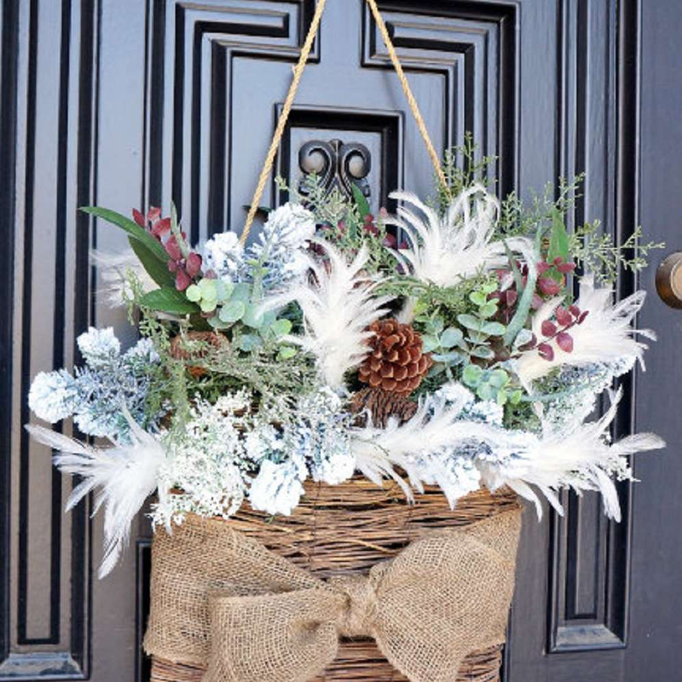 hanging basket with branches on a front door