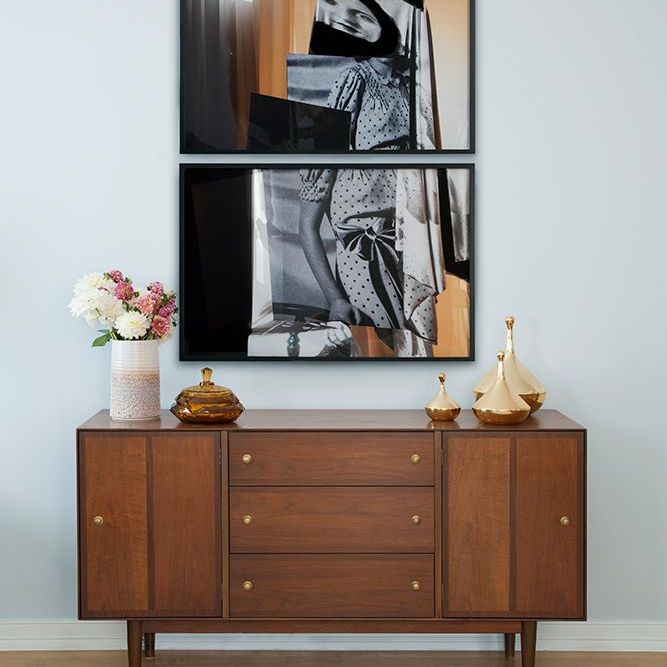 a credenza features multiple vases and abstract art