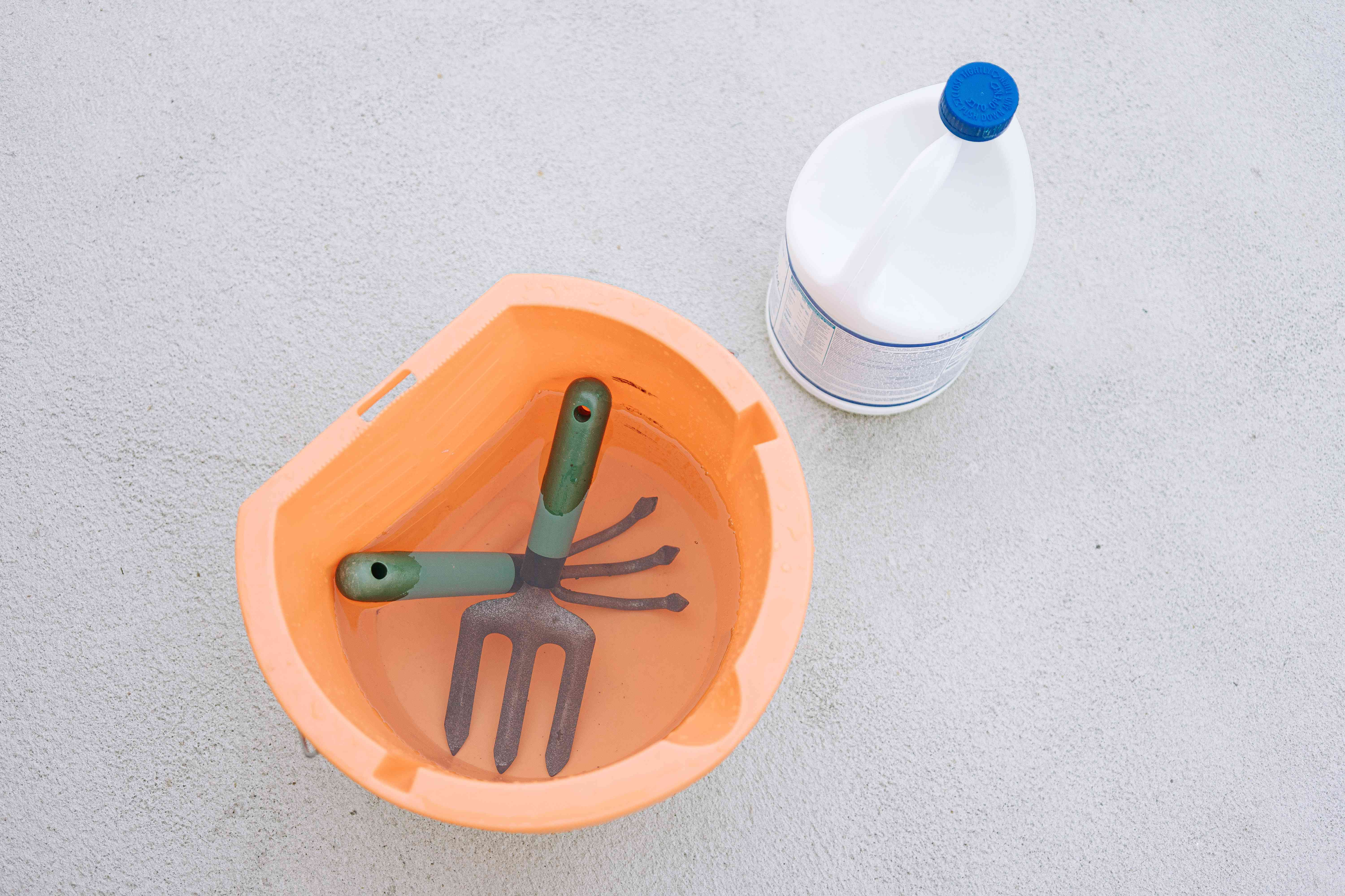 disinfecting tools in a bleach solution
