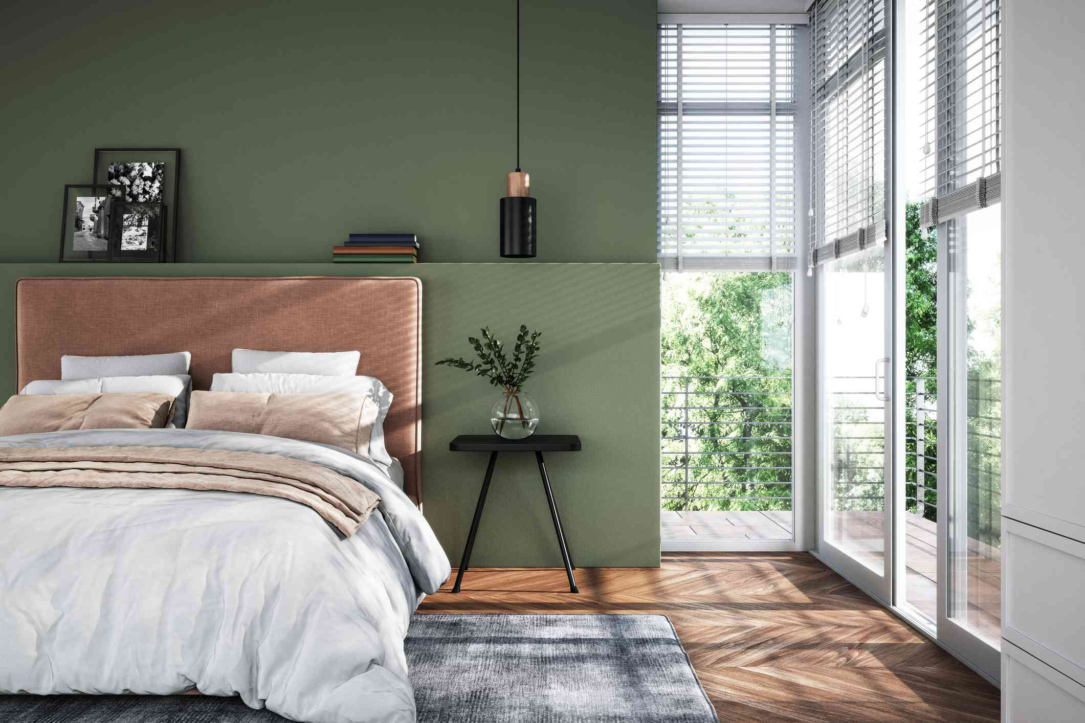 modern bedroom with green walls and brown accents, natural light