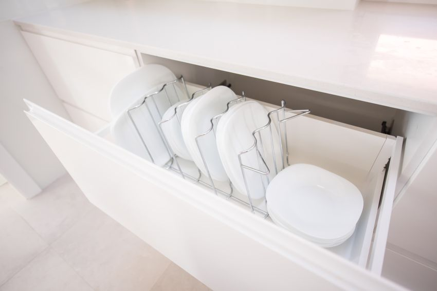 Plates in a kitchen drawer, High quality photo