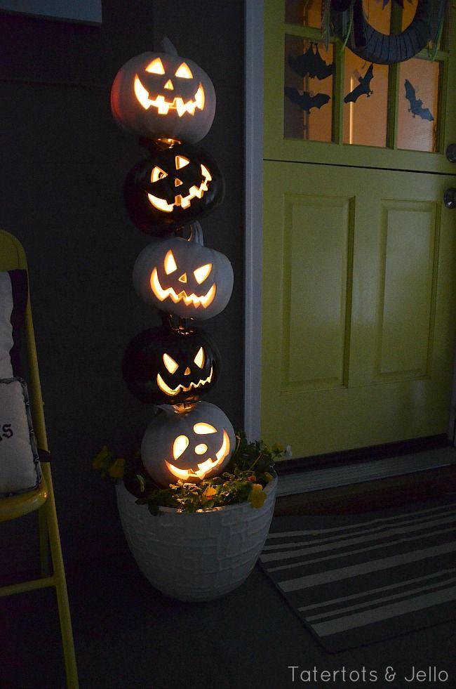 A lit up pumpkin topiary