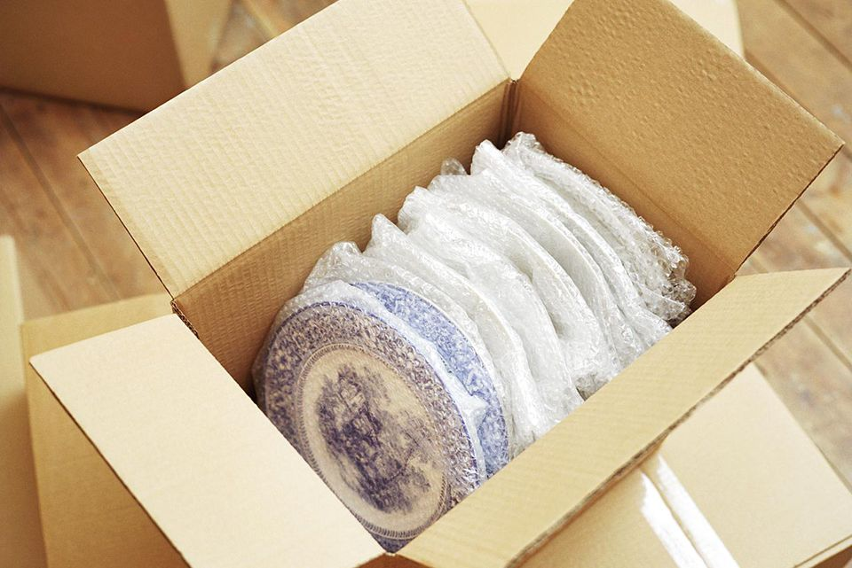 Plates packed in a moving box