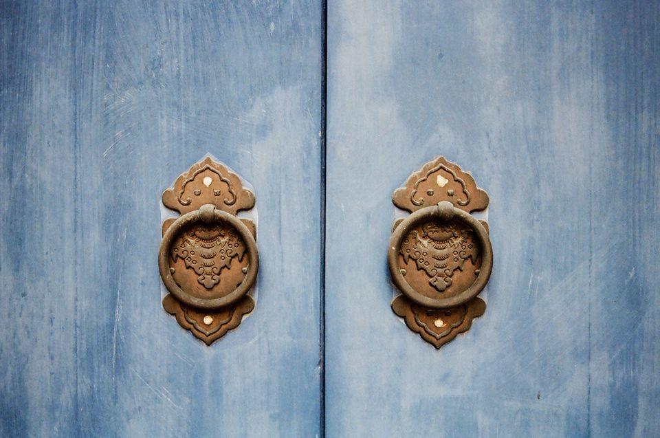 Door knocker on blue temple doors