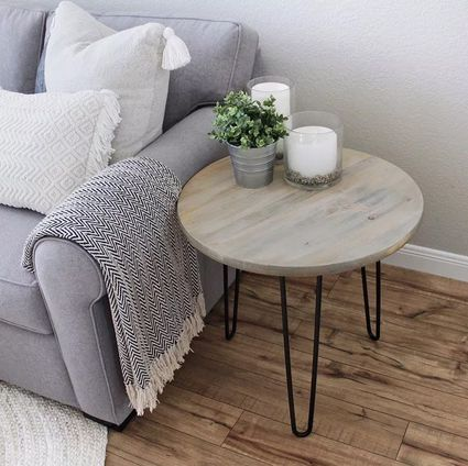 A hairpin end table sitting by a gray sofa
