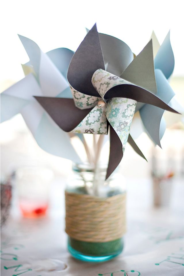 Pinwheels in a vase covered with twine