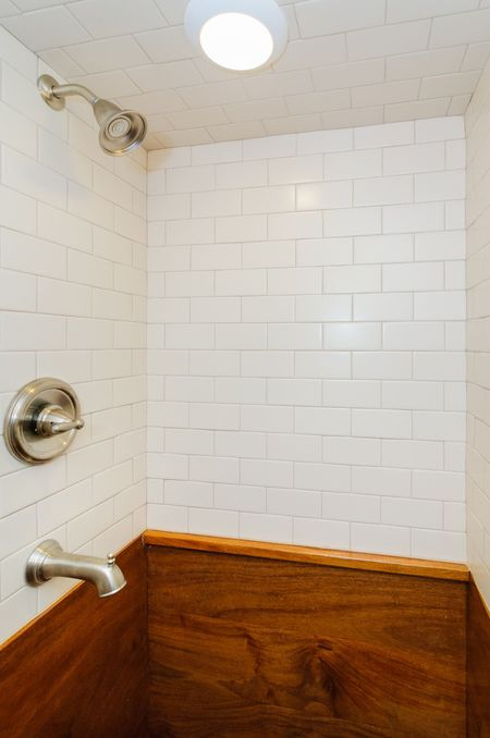 Subway Tile And Wood Walls In Shower Stall Wishbone Tiny Homes