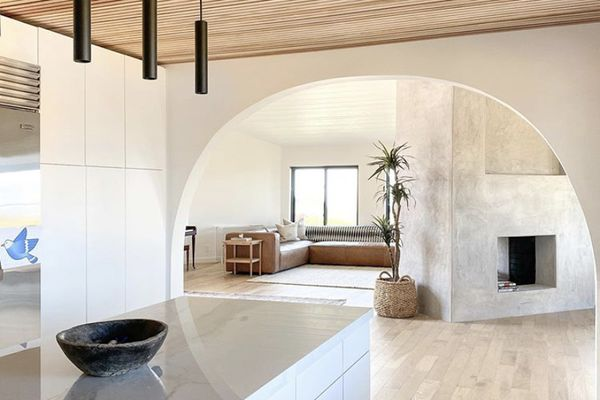 White minimalist kitchen and living room