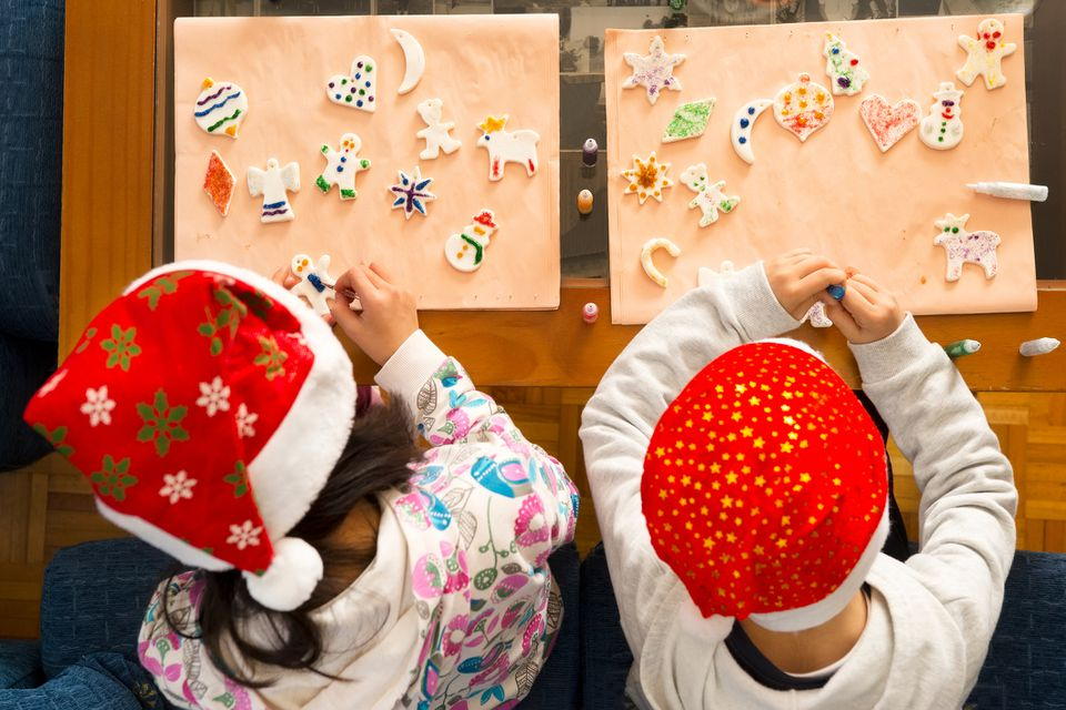 Two kids decorating Christmas cookies