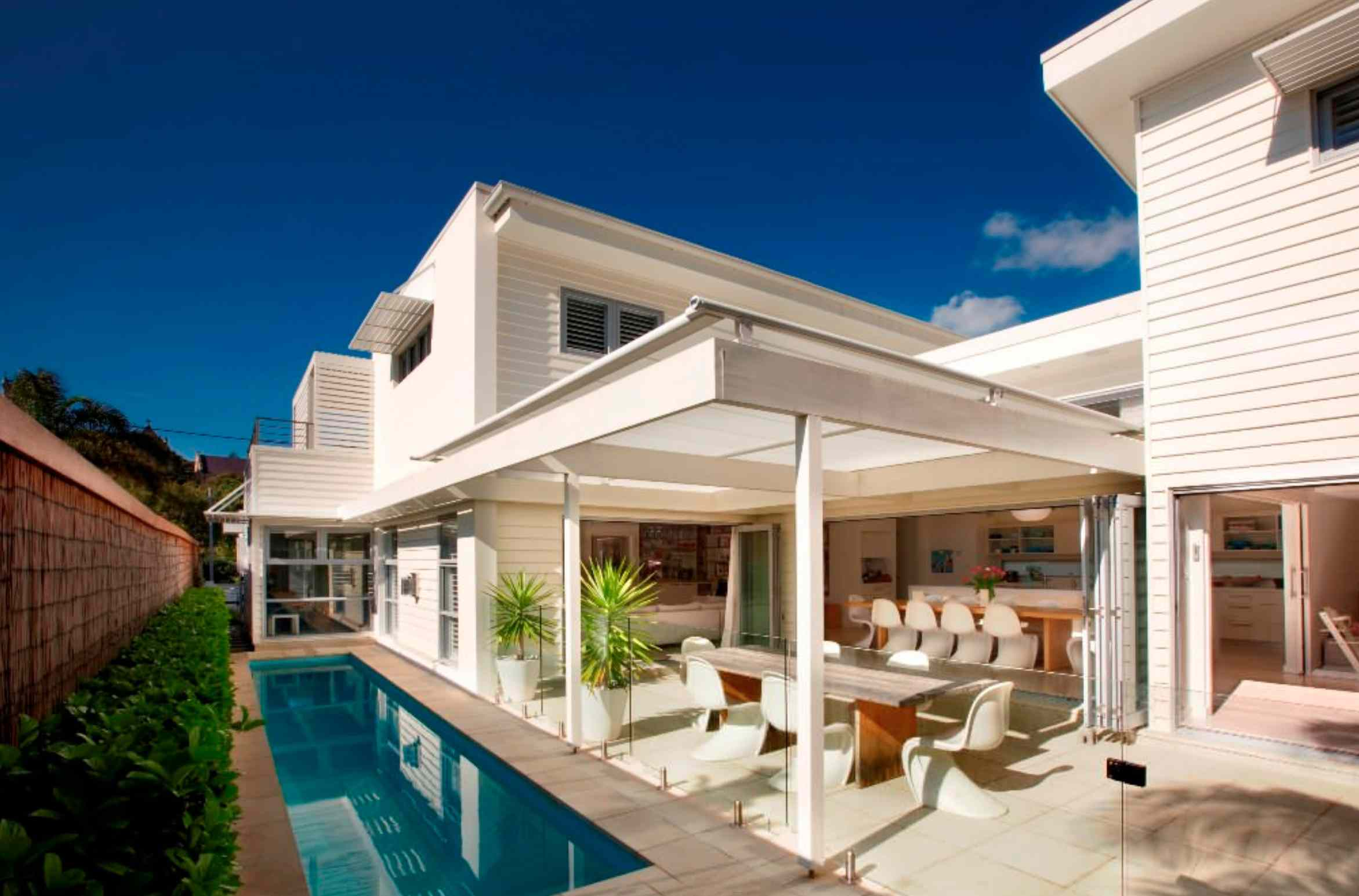 covered patio modern white house outdoor bar and pool