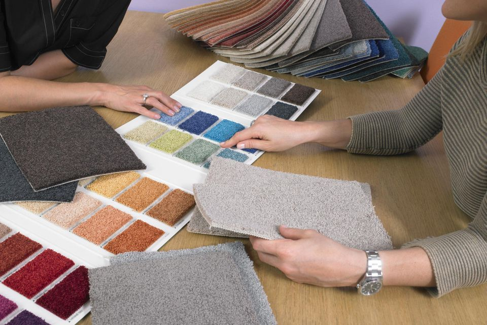 Designer showing carpet color samples to a client