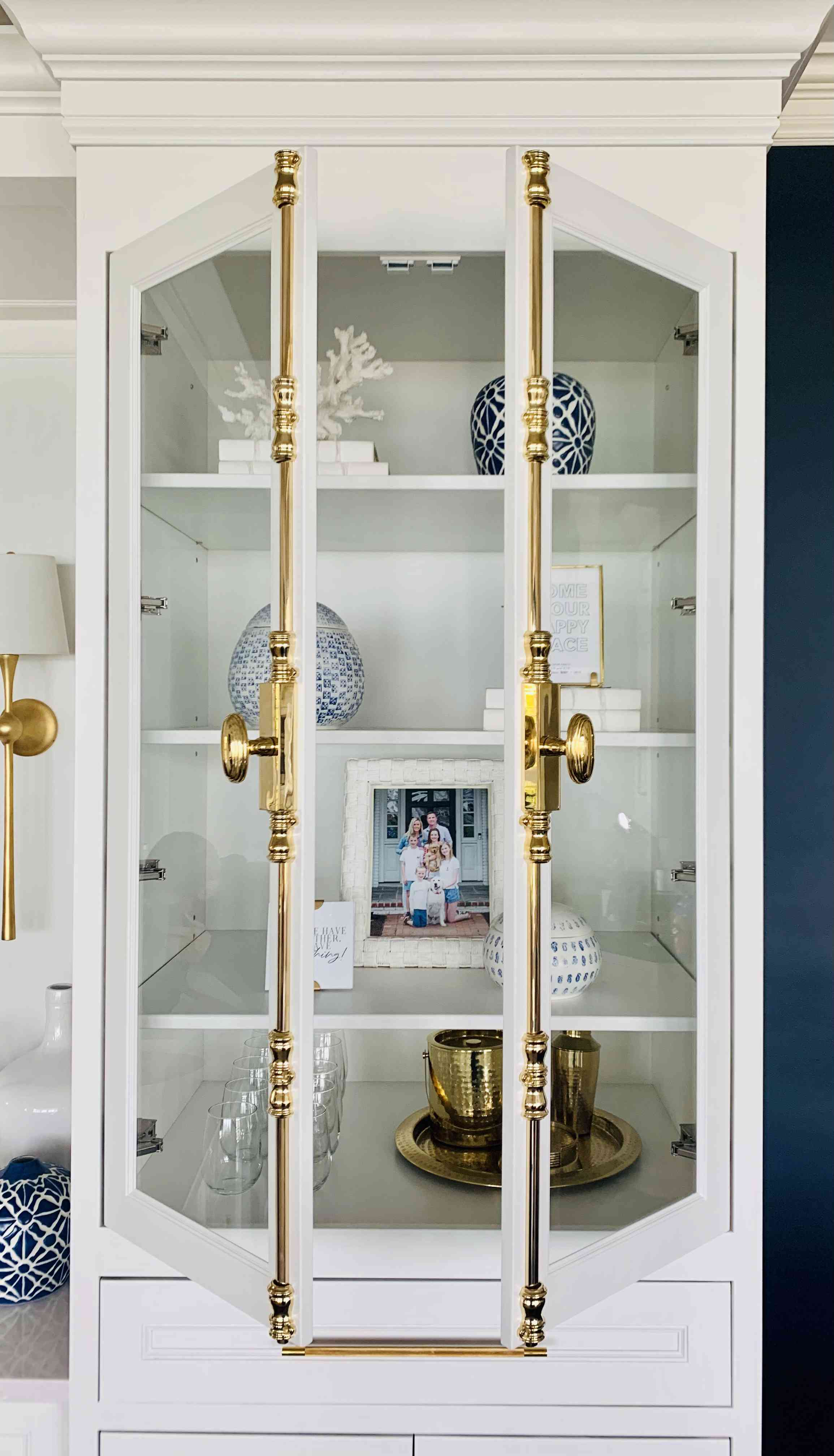 styled shelves feature white, blue, and gold elements