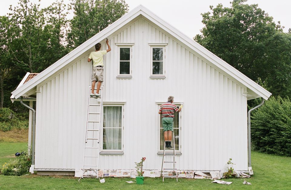 Men painting house exterior