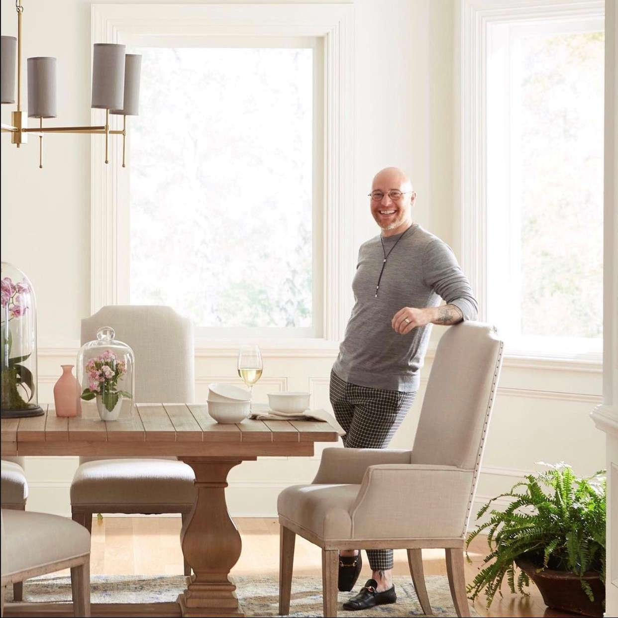 Roberson Keffer poses next to a dining table