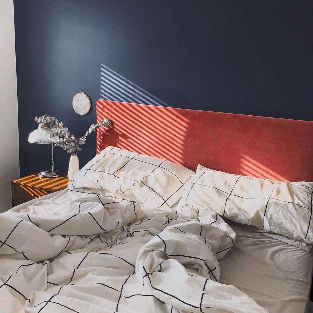 Bedroom with navy walls