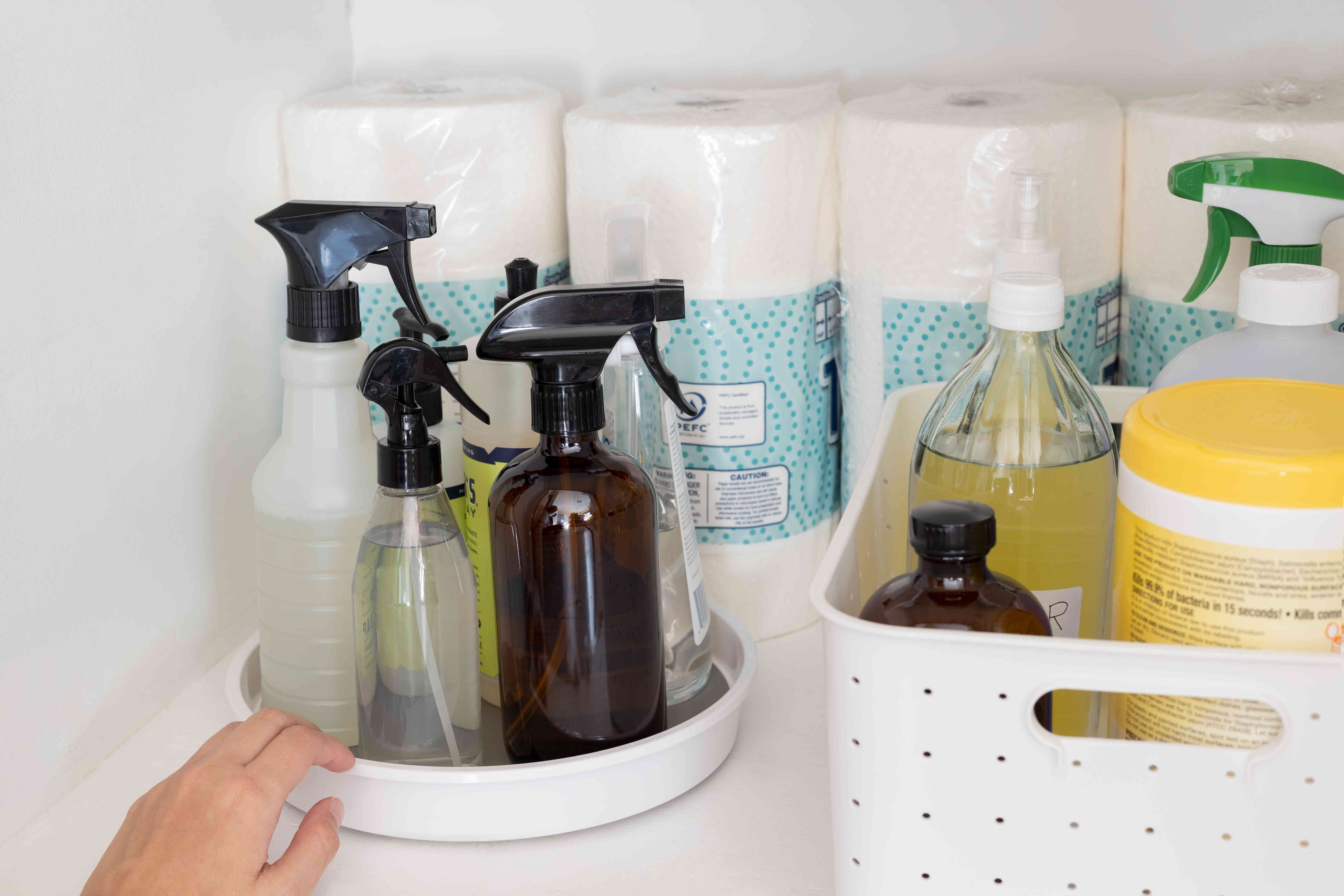 Lazy Susan turntable storing spray bottles for easier access