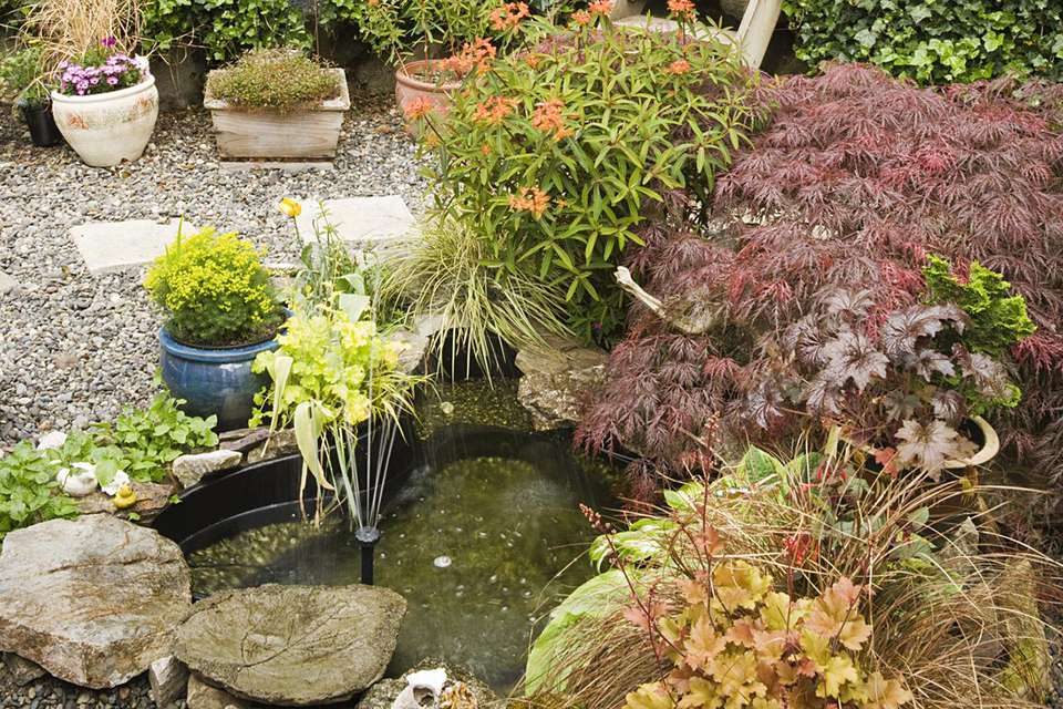 Small fountain framed by terraced gardens