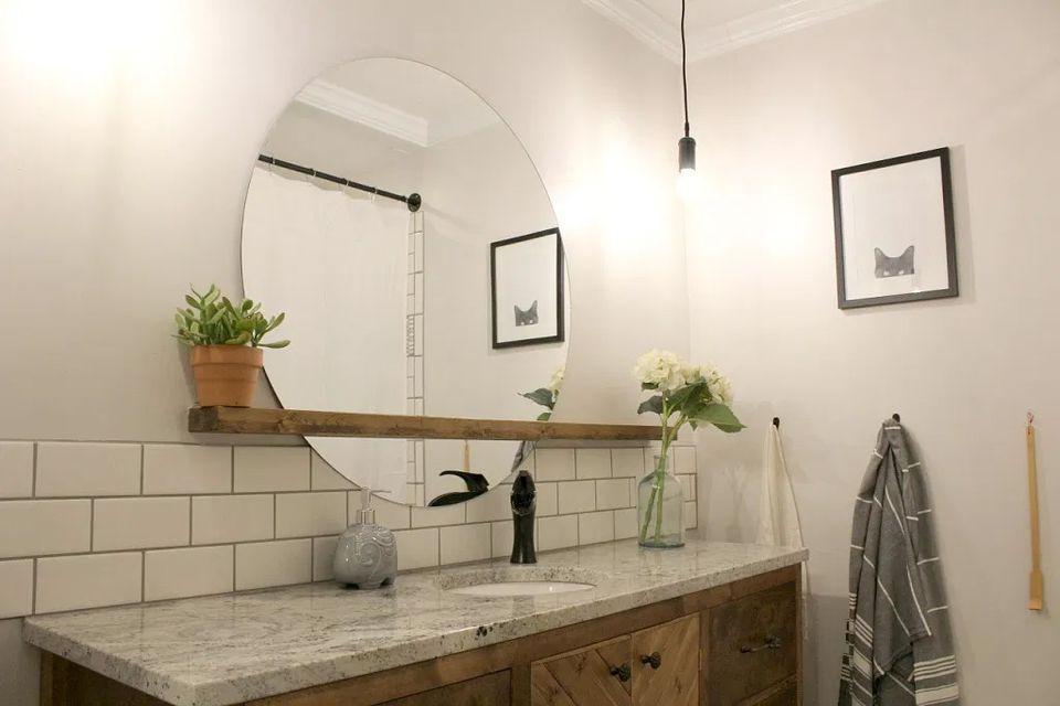 A floating mirror and shelf in a bathroom
