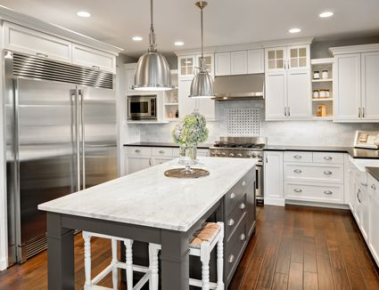 White and gray kitchen with laminate wood flooring