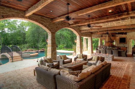 Covered Patio Outdoor Living Room With Pool And Bridge