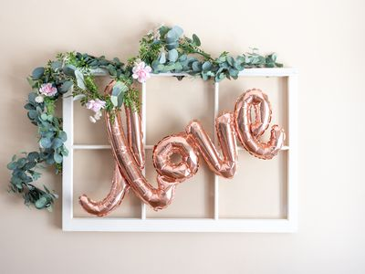 Love balloon on rustic white window frame