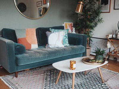Small living room with a green couch