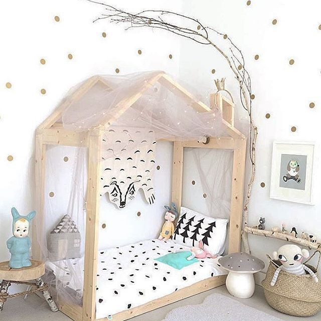 Scandinavian style kid's room with woodland theme