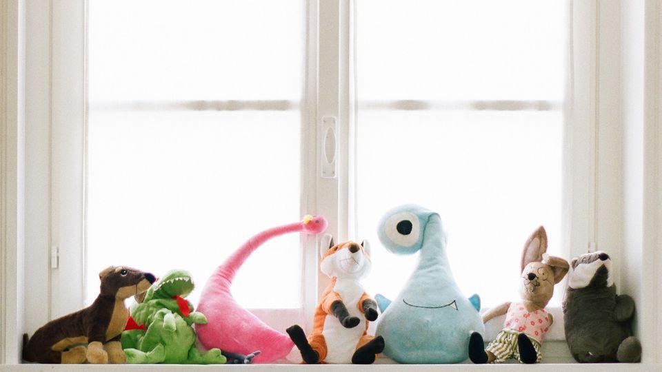 Stuffed animals on windowsill