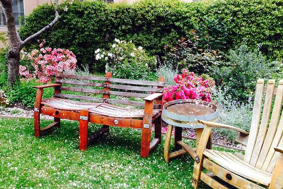 Rustic garden bench in spring
