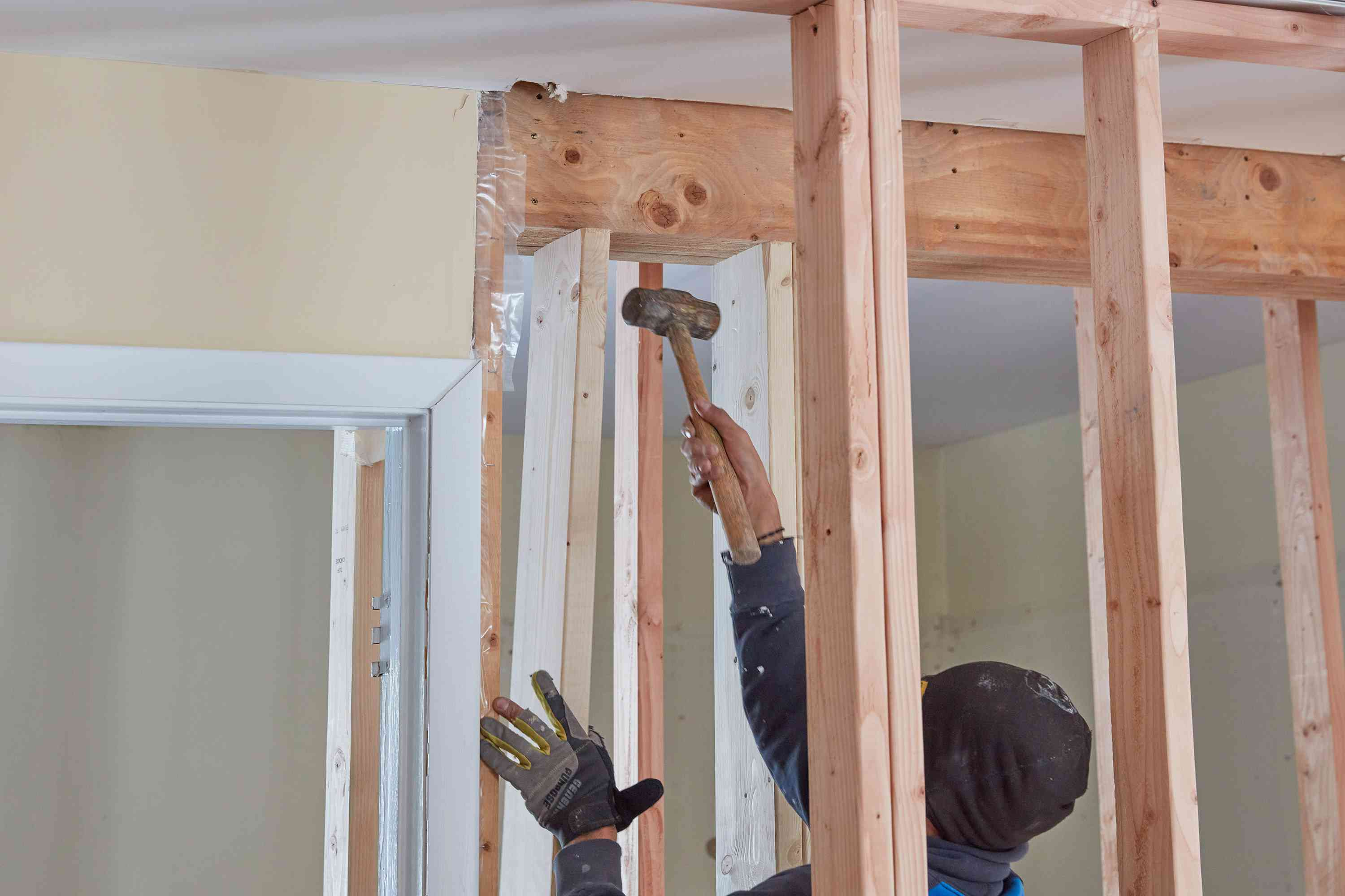 First jack stud hammered into place of load bearing wall