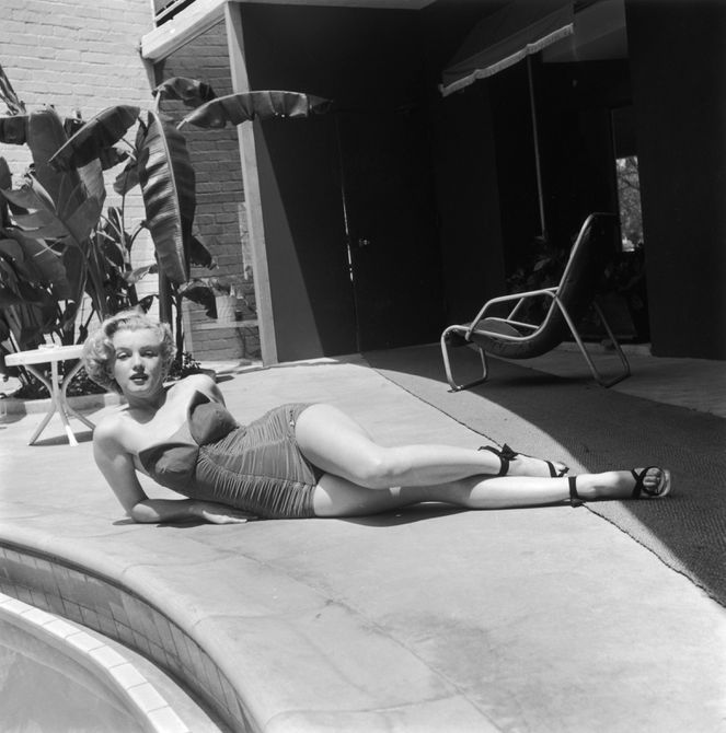 The actress strikes a distinctly Marilyn pose next to her Hollywood swimming pool