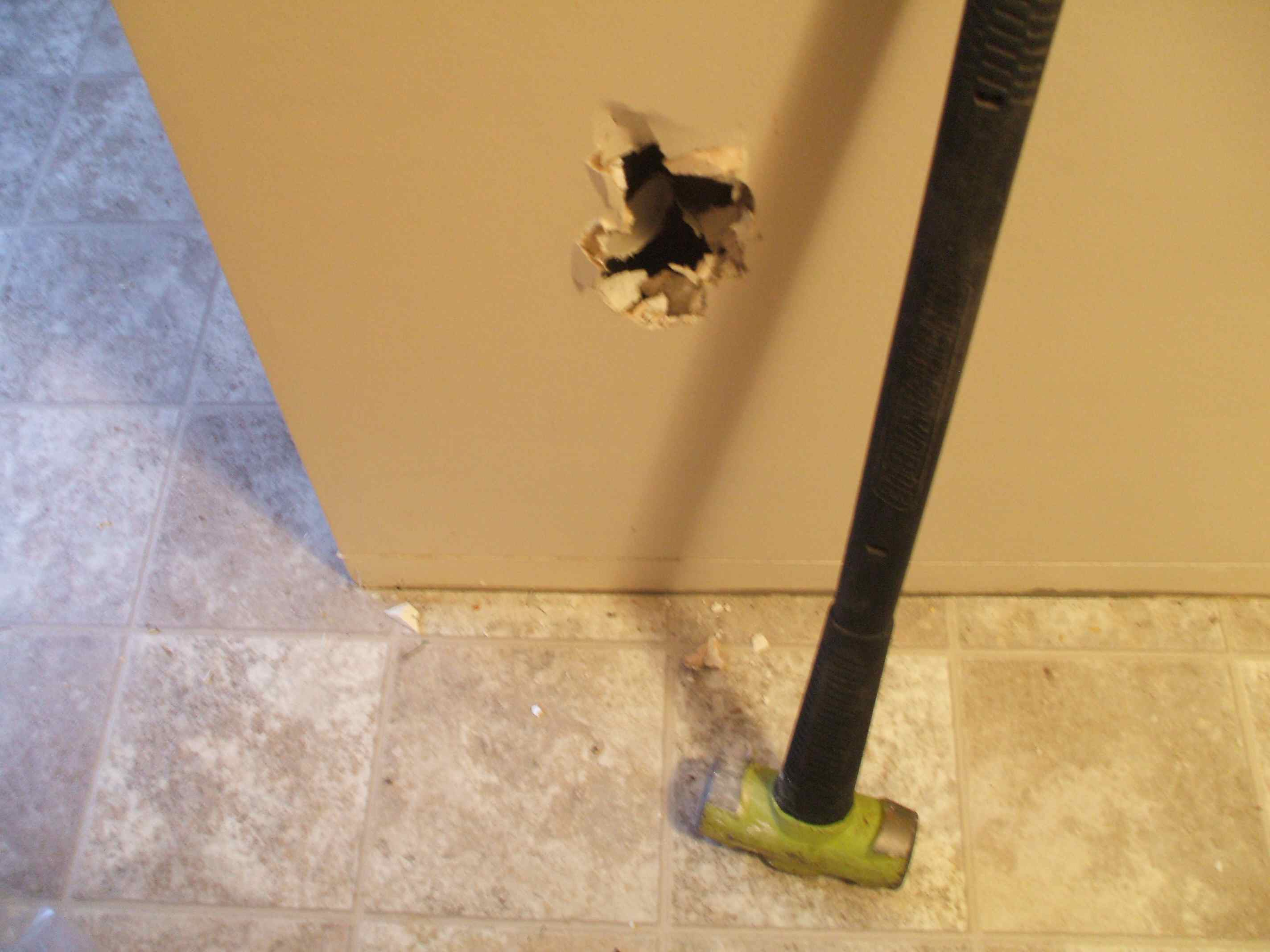 Punching a hole in an interior wall