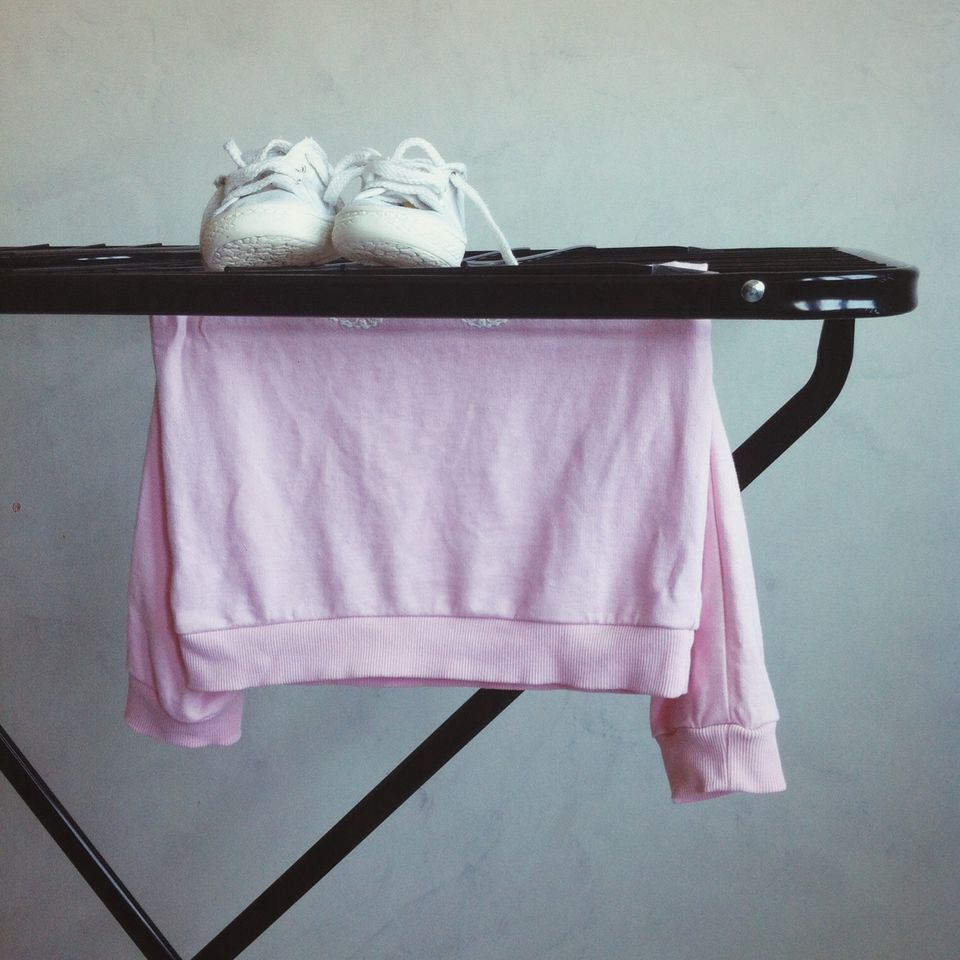 Shoes And T-shirt On Drying Rack