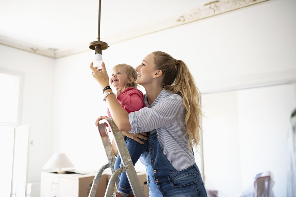 DIY mother and daughter changing light fixture