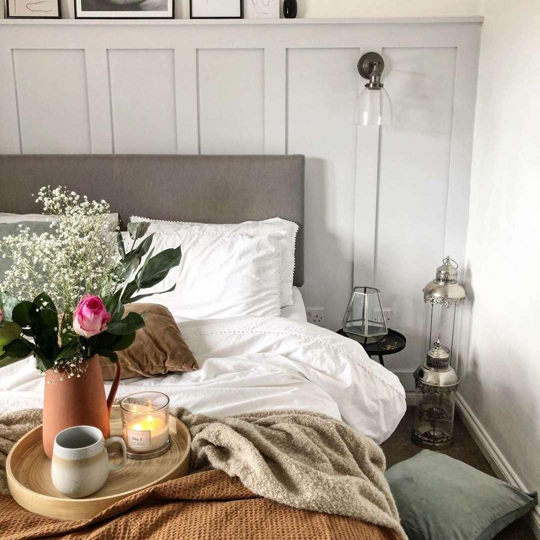 Bedroom with burnt orange bedspread