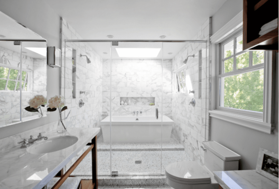 A double shower in a white bathroom