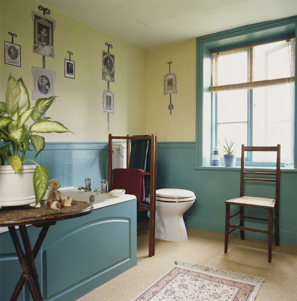 Bathroom with wooden tub enclosure and matching wainscot