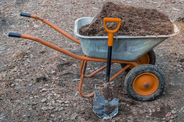 Fill dirt in a wheelbarrow