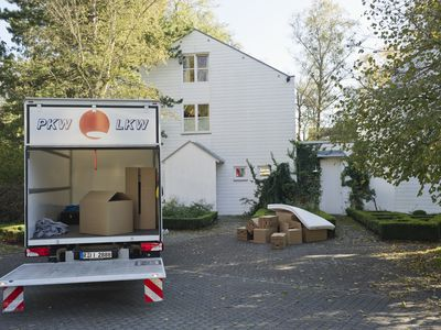 Germany, Bavaria, Grobenzell, Truck with cardboard boxes for moving house